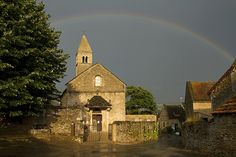 Rainbow over church in Taize 2010
