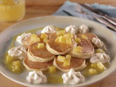 Silver Dollar Tropical Pancakes with Mascarpone Whipped Cream recipe from Bobby Flay via Food Network