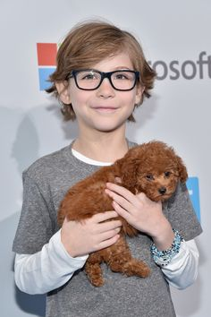 Jacob Tremblay, the adorable actor and star of Room, brought his family's new addition, a poodle puppy named Rey, to the WE Day California event in L.A. on Thursday