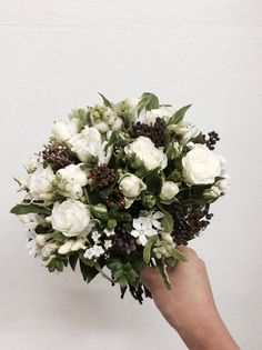 Shop girl flower girl wedding posy. Signature style, standard price. Dark foliage, white florals
