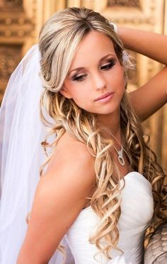 Bride's side part, half updo long curls with under veil