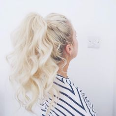 The wavier the better. Wear your luscious curls in a high ponytail for an edgy yet casual look