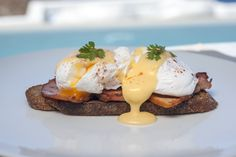 Eggs benedict with smoked Apaki ham and classic Hollandaise sauce at Grace Santorini.