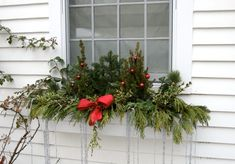 image windows decorated for christmas | The icicles hanging from this box are a fun idea. You can use beaded ..