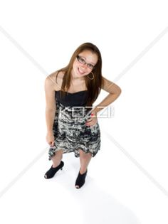 high angle view of a teenage girl with hand on hip. - Portrait of a teenage girl posing with hand on hip over white background.
