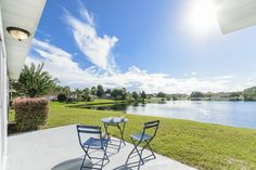 Lakeside view with pretty blue chairs on Jacksonville's Westide.