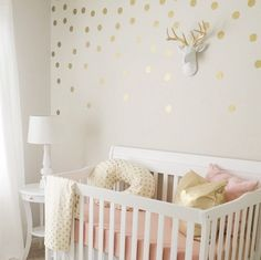 Obsessed with this pink and gold nursery!