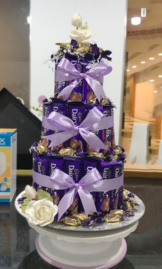 Delectable Cadburys and Eclairs in an enchanting tower, great for birthdays, parties, gatherings Chocolate Basket, Chocolate Hampers, Chocolate Pack, Chocolate World, Chocolate Gifts, Chocolate Lovers, Cadbury Chocolate, Chocolate Chocolate, Candy Bouquet Diy