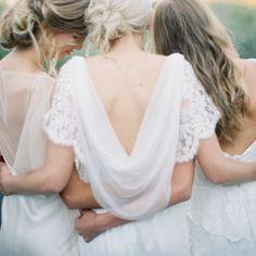 Loving this beautiful draped back wedding dress