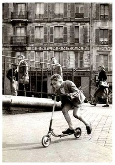 On faisait de la trottinette à Ménilmontant,  Paris.  By Robert Doisneau, 1934.