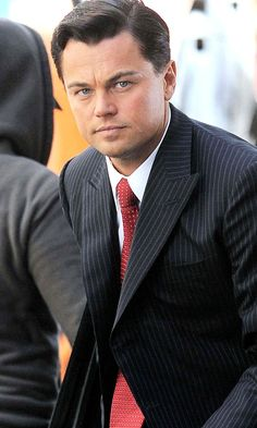 Leonardo DiCaprio on the set of The Wolf of Wall Street. idk but i'm really loving his dark hair