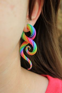 crazy ear plugs. not a big fan of plugs but can't help but say this is amazing looking. i-found-it-on-etsy:  Technicolor Polýpous Plug...