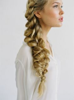 "Braids look chic even when ""imperfectly messy"". Here are a few examples of beach bridal braids to get you thinking about your own braided wedding hairstyle."