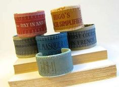 Old book cover bracelets...how fun are these?!  I sure would wear one!  :)