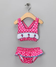 Take a look at this Pink Polka Dot Smocked Bikini - Infant, Toddler & Girls by Dibble Dabble Dandy on #zulily today!