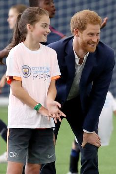 Prince Harry Celebrates the Royal Baby News by Bonding With Children in Manchester