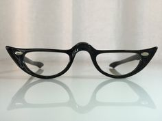 VINTAGE NOS Tart Optical Enterprises Cute Black Cat Eye Women's 1950s Half-Eye Glasses Frames or Readers by SpecsOptical on Etsy https://www.etsy.com/listing/220827452/vintage-nos-tart-optical-enterprises