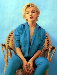 The wicker chair sitting by Milton Greene, 1954.