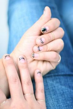 Let your nails do the flirting for you with this winking nail design by Honestly WTF. With only a few supplies, this design can be all yours.