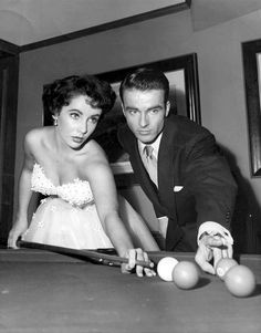 Montgomery Clift playing pool with Elizabeth Taylor