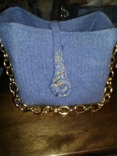 "This purse is a lavender/blue shade.  I embellished the I-cord weighted flap with some sparkly accent yarn and added a gold chain strap.  Finished size:  9"" wide, 7.5"" high, 5"" on sides."