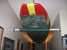 paddleboard ceiling storage idea. save so much space and money on buying a rack when you can make one like this.