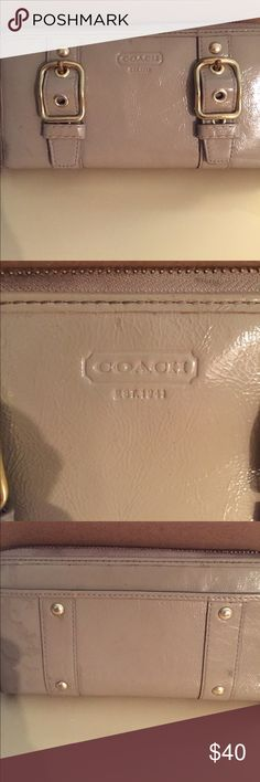 VINTAGE COACH WALLET IN BEIGE VINTAGE COACH WALLET IN BEIGE. HAS OUTSIDE POCKET WITH INSIDE ZIPPER POCKET AND TWO OTHER POCKETS BEHIND MULTIPLE CREDIT CARD STORAGE ON EITHER SIDE INSIDE WALLET.  ZIPPER CLOSE. IN VERY GOOD CONDITION WITH ONE MARK TO ZIPPER MATERIAL AS SEEN IN  2nd TO LAST PICTURE. COACH Accessories