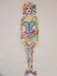 This is so beautiful! Tattooed Lady embroidery..