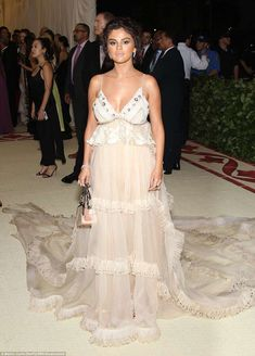 Glittering: Selena Gomez arrived in a sheer ruffled look by Coach with gold shadow on her ... #metgala #selena gomez