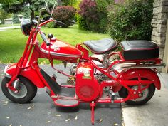 1954 Cushman springer Eagle. What a mess when i bought it. See the before shot, blue and gray.