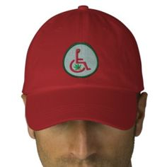 The original registered color scheme of the 'Wheel Chair Surfer' Logo Badge of the Medical Marijuana Initiative of North America - International set against a men's red adjustable baseball - softball cap. Copyright Information: Medical Marijuana Initiative of North America - International © 2000 - 2015. The  'Wheel Chair Surfer' Logo Badge is a registered trademark of the Medical Marijuana Initiative of North America - International.