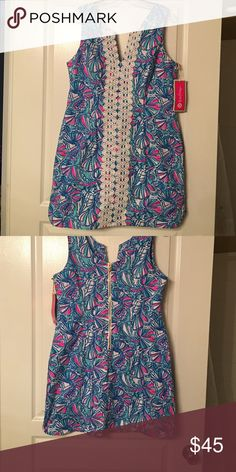 My Fans Lilly for Target Shift Dress Size 14 Did you miss out on the Lilly for Target collection? Fear not! This Lilly for Target dress is in pristine condition! This classic shift has never been worn, and still has the tag on it. It also features classic Lilly touches, such as a gold pineapple zipper, and embellishments on the front. Lilly Pulitzer for Target Dresses