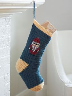 Cross Stitch Christmas Stockings - Patterns | Yarnspirations   Bring the holiday spirit into your home with these charming cross stitch stockings.