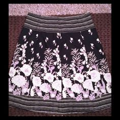 Van Heusen floral skirt Beautiful black, tan and creme floral skirt by Van Heusen. Like new condition. Lightweight and ready for spring. Would look great with a black top and flats. Van Heusen Skirts Midi