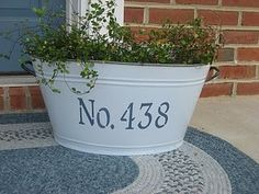 Cute idea...bucket/tub with house number