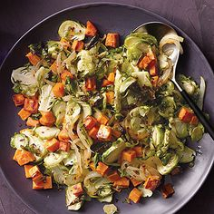 This Brussels sprouts and sweet potato salad is the perfect holiday side, and it's healthy too! Get the wholesome recipe here. | Health.com