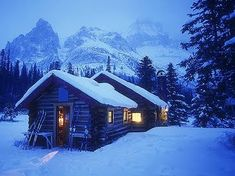 tiny winter cabin in the mountains