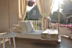 Hanging Daybed.  Would love a large porch to be able to do this...