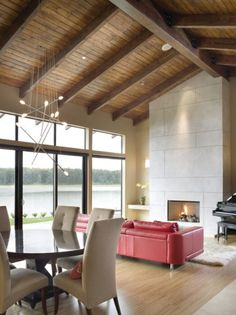 exposed wood ceiling, brick fireplace | ... living room with a vaulted wooden ceiling and exposed beams. Floor to ceiling windows!! AAaaaahhh