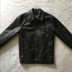 """Aeropostale Leather Jacket NWOT. Aeropostale PU leather jacket. Size XS. Underarm to underarm approx 18 1/2"""", Sleeve approx 24 1/2"""", and Shoulder to Hem approx 25 1/2"""".  Shell: 100% PU. Lining: 100% Polyester. Padding: 100% Polyester. One inside and 3 outside zipper pocket.  This is dark brown in color with a vintage look. Very sharp looking leather jacket and well made.  My son never wore this. I was going to keep it for myself for riding but it's too big on me. Aeropostale Jackets & Coats"""