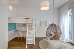 A hanging chair adds a relaxing element to the room