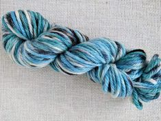 Chunky weight hand dyed yarn in light blue with black splashes Big Needle, Black Splash, Hand Dyed Yarn, Light Blue, Wool, Knitting, Pattern, How To Make, Crafts