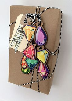 Jewels and craft paper - high/low fashion.  cleomade gift tags