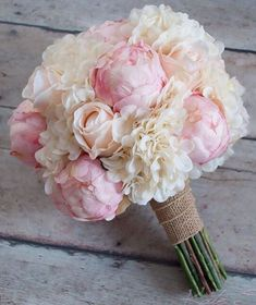 Hydrangeas works well by themselves or as a perfect duo with peonies, like in the bouquet below. Like irises, they come in a variety of colors. However, their shades tend to be softer and more subdued, giving your summer wedding flowers a romantic feel. | Hydrangea | 7 Must Have Summer Wedding Flowers | My Wedding Favors #weddinganniversarygifts