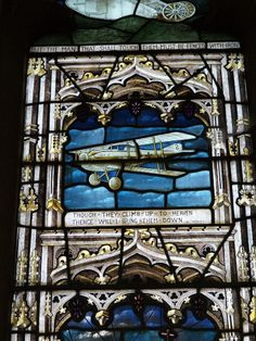 Description: Swaffham Prior, England: St Mary's Church: Great War (World War I) left memorial window (German aeroplane) (1919, designed by T F Curtis, made by Ward and Hughes)