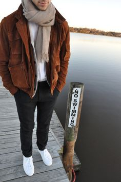 Wear a brown suede bomber jacket and black wool dress pants for a sharp, fashionable look. If you don't want to go all out formal, grab a pair of white low top sneakers.  Shop this look for $389:  http://lookastic.com/men/looks/low-top-sneakers-scarf-dress-pants-cardigan-crew-neck-t-shirt-bomber-jacket/4133  — White Low Top Sneakers  — Beige Cotton Scarf  — Black Wool Dress Pants  — Grey Cardigan  — White Crew-neck T-shirt  — Brown Suede Bomber Jacket