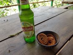 """Kingfisher"" is India's Budweiser, and very good at that. The snack biscuits pictured are called ""chakli"""