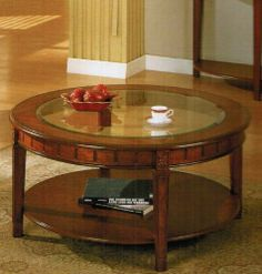 "5mm Tempered Glass Top Round Coffee Table in Cherry Finish by H-M SHOP. $290.72. Finish: Cherry. No delivery for Alaska, Hawaii. Matching end table and console table are sold separately.. 5mm tempered glass top. Coffee Table: 40"" Dia. x 19""H. The coffee table features 5mm tempered glass top inserted and a shelf.  Solid wood coffee table provides a traditional style and a comfortable atmosphere to your living room with its cherry finish. Shelf provides plenty of storag..."
