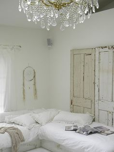 Distressed wood with crystal chandelier. Layers of white and cream. A little bit boudoir but still very clean.