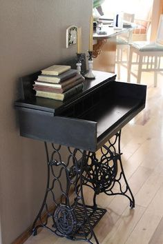 Turn a treadle sewing machine into a desk! I like this.
